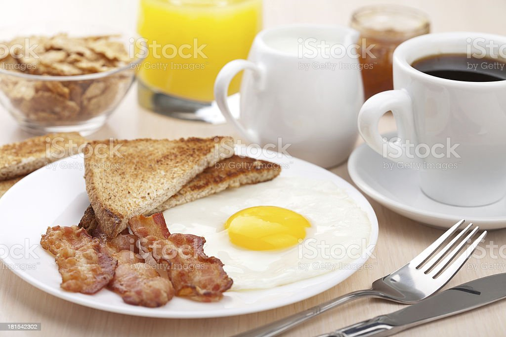 traditional breakfast with fried egg and bacon stock photo
