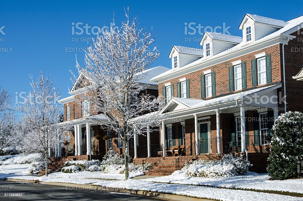 Traditional Brick Homes After a Winter Snow Storm stock photo