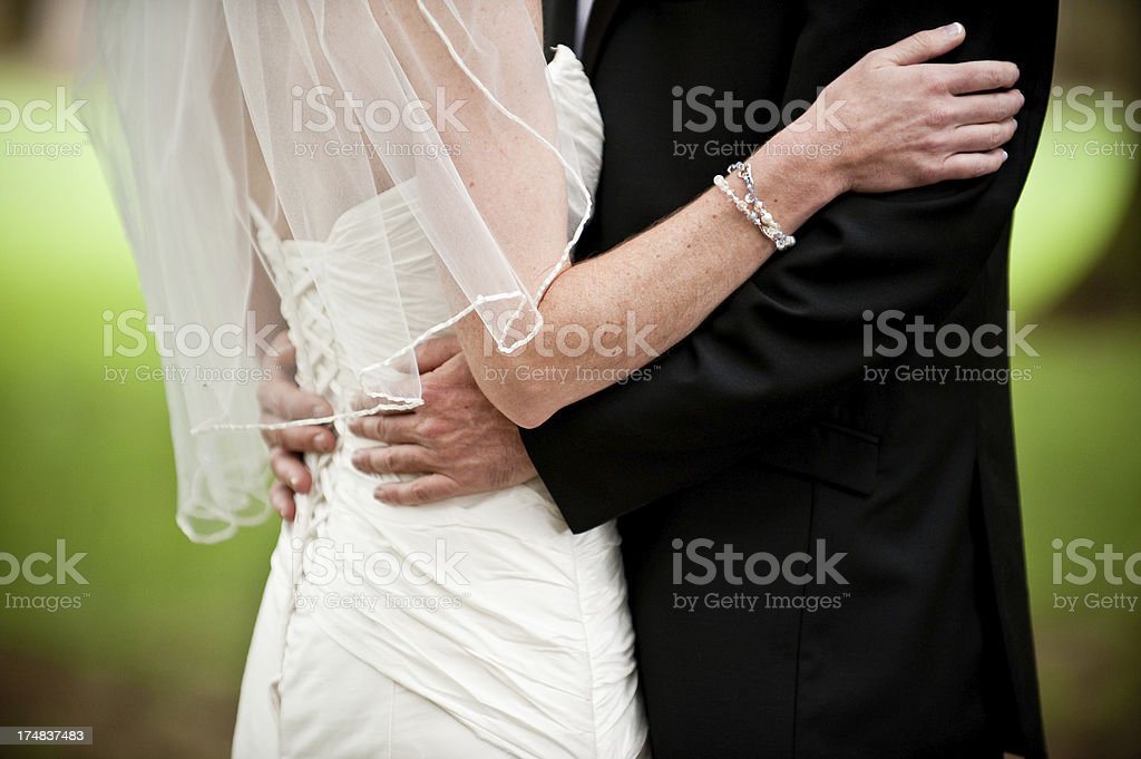 Traditional Bride and Groom Embrace on Wedding Day Holding Close royalty-free stock photo