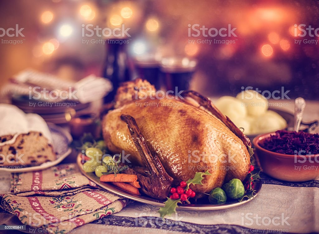 Traditional British Holiday Goose Dinner with Apples and Brussels Sprouts stock photo