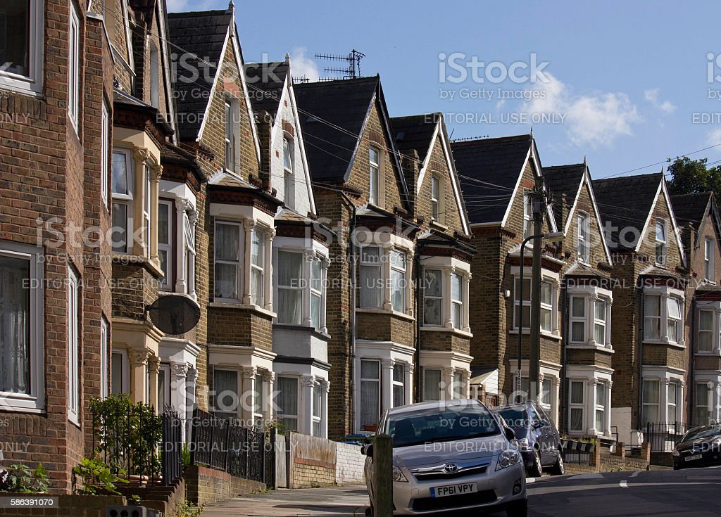 Traditional british houses in a row stock photo