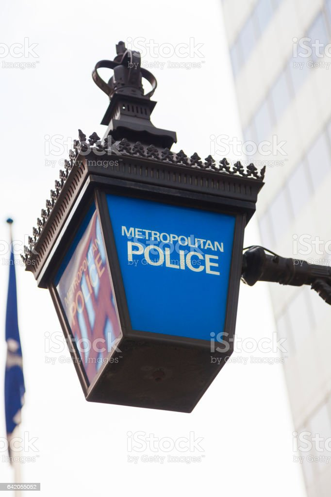 Traditional British Metropolitan Police lamp sign outside police station, London, England stock photo