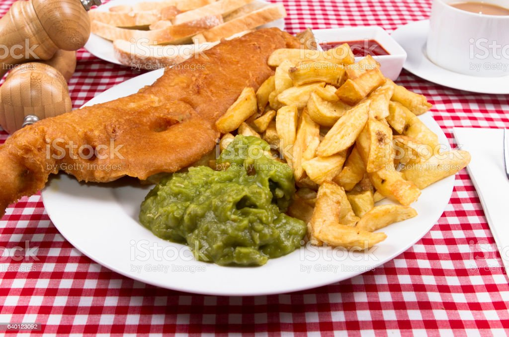traditional British plate of fish and chips stock photo