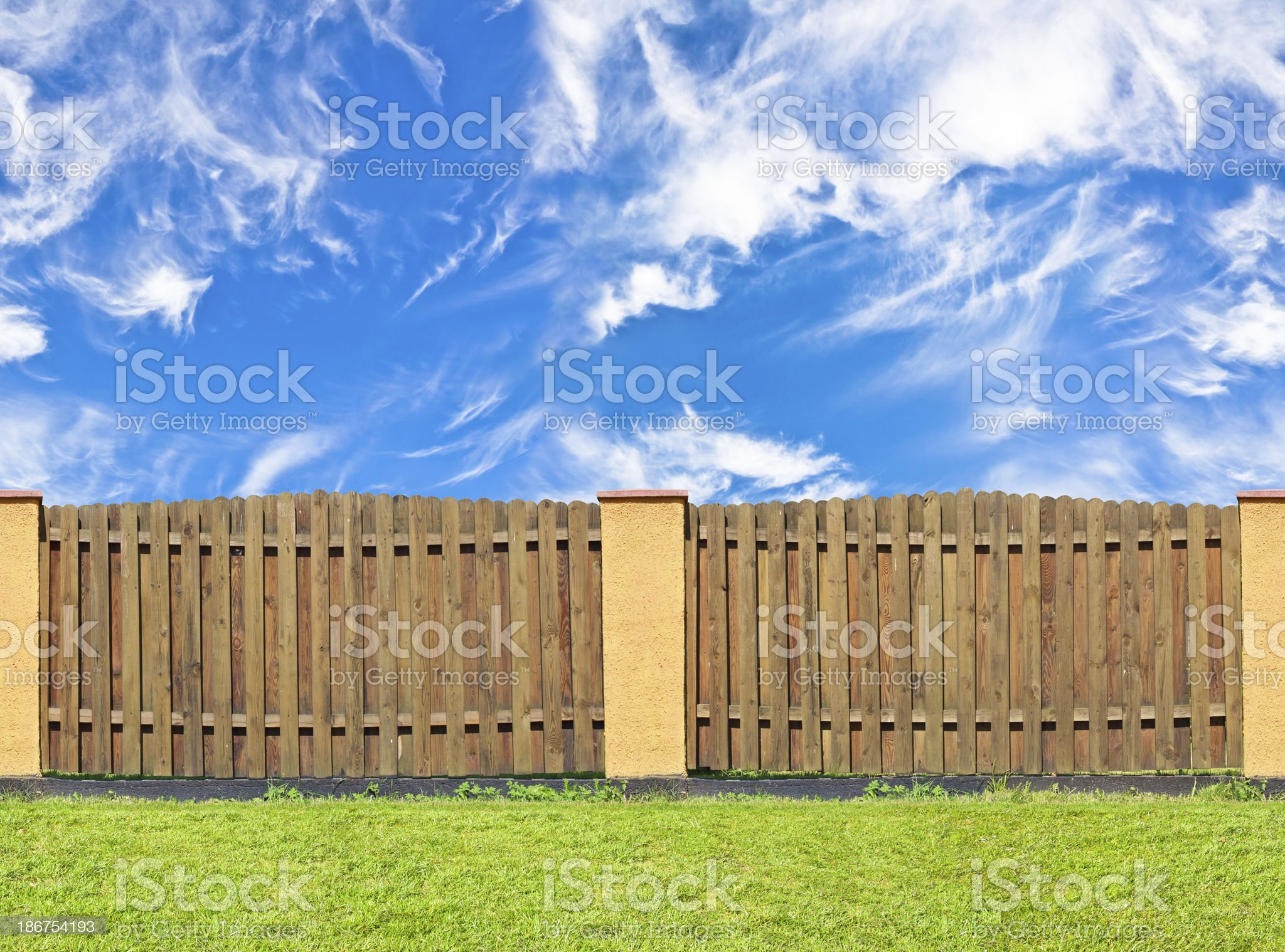 traditional brown pine wooden fence royalty-free stock photo