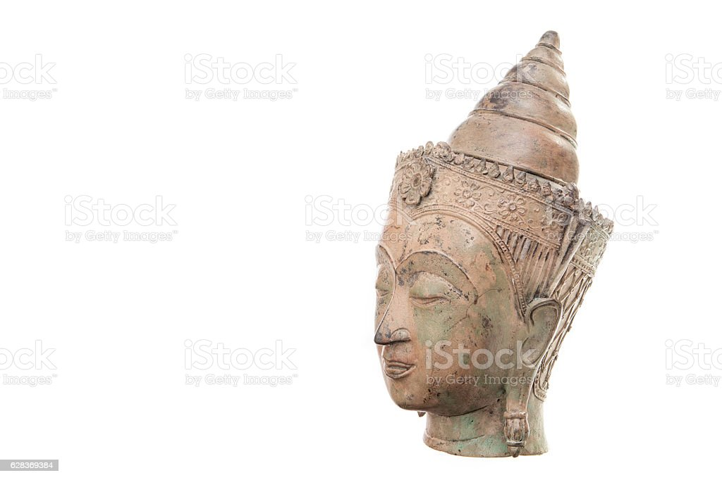 Traditional Buddha head against white background with copy space stock photo