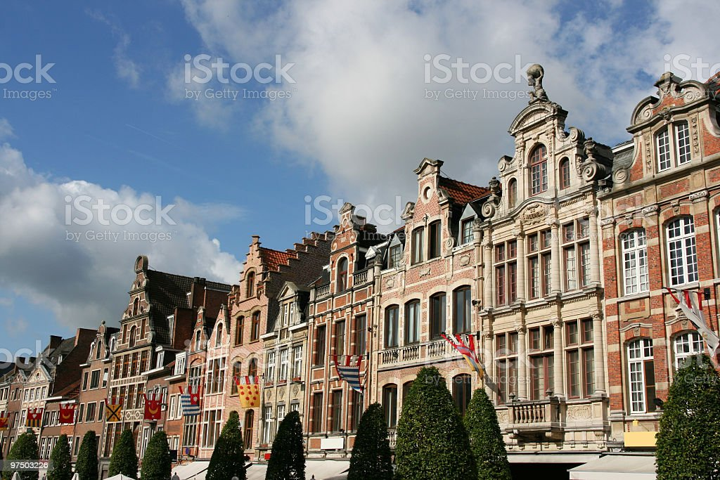 Traditional building exteriors of homes in sunny Belgium royalty-free stock photo