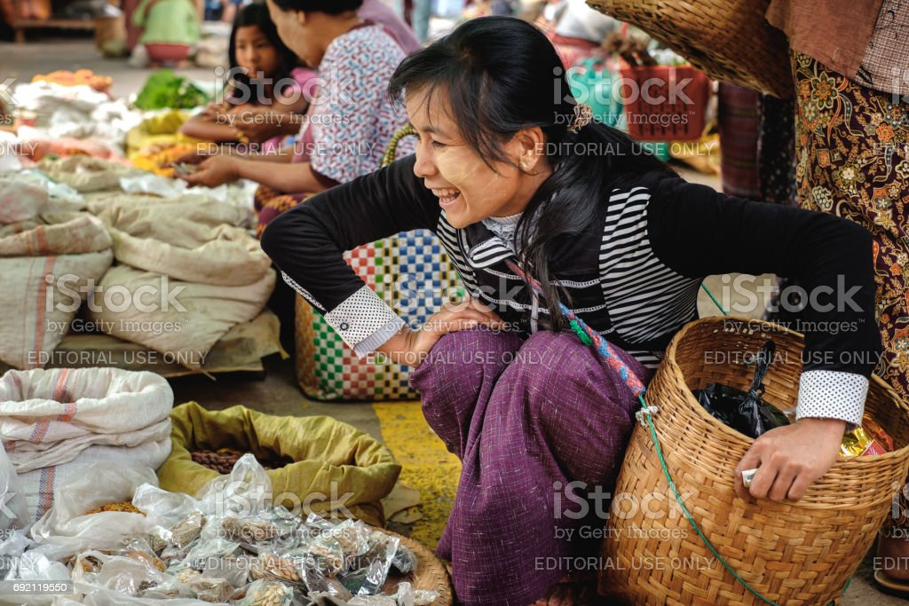 Traditional burmese woman on the street market stock photo