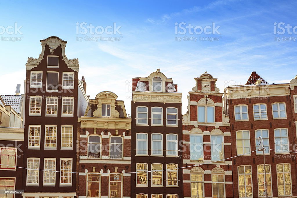 Traditional canal houses in Amsterdam stock photo