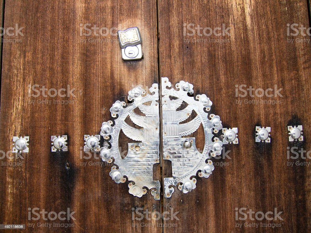 Traditional carved silver decorated door panel stock photo