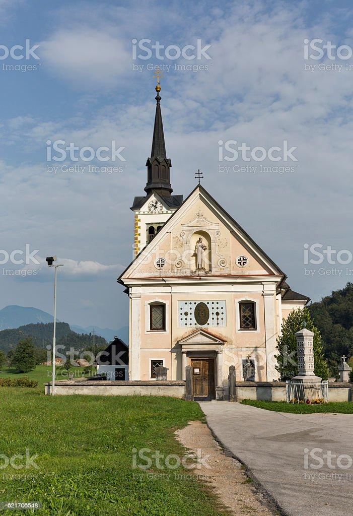 Traditional catholic church in Bohinjska Bela village near Bled, Slovenia. stock photo