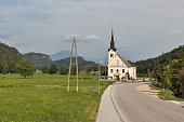 Traditional catholic church in Bohinjska Bela village near Bled, Slovenia.