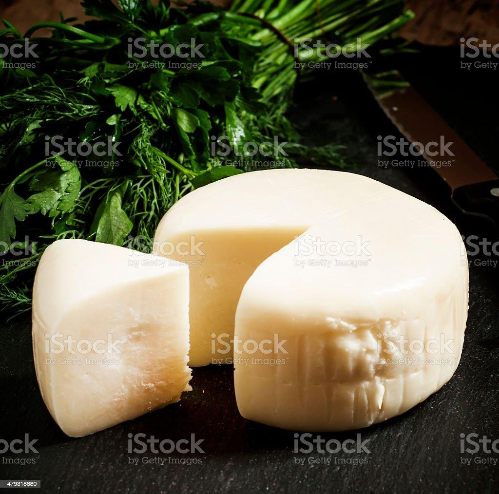 Traditional Caucasian homemade cheese sulguni stock photo