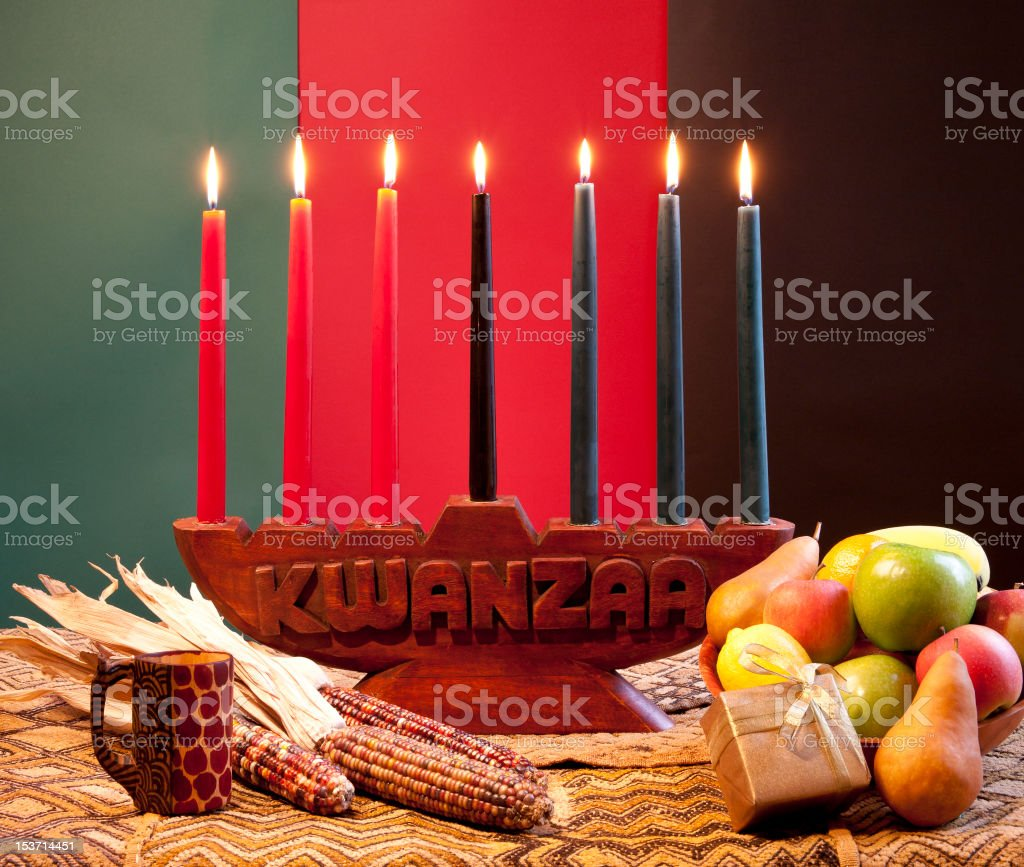 Traditional celebration of Kwanzaa with corns and fruits stock photo