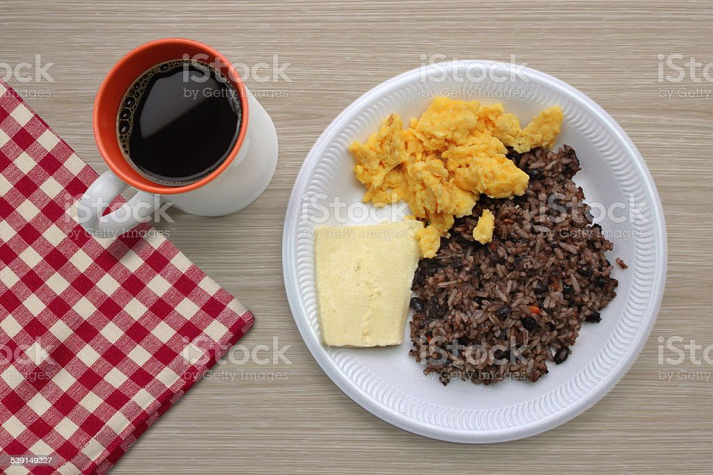 Traditional Central American breakfast - gallo pinto, eggs and cheese stock photo