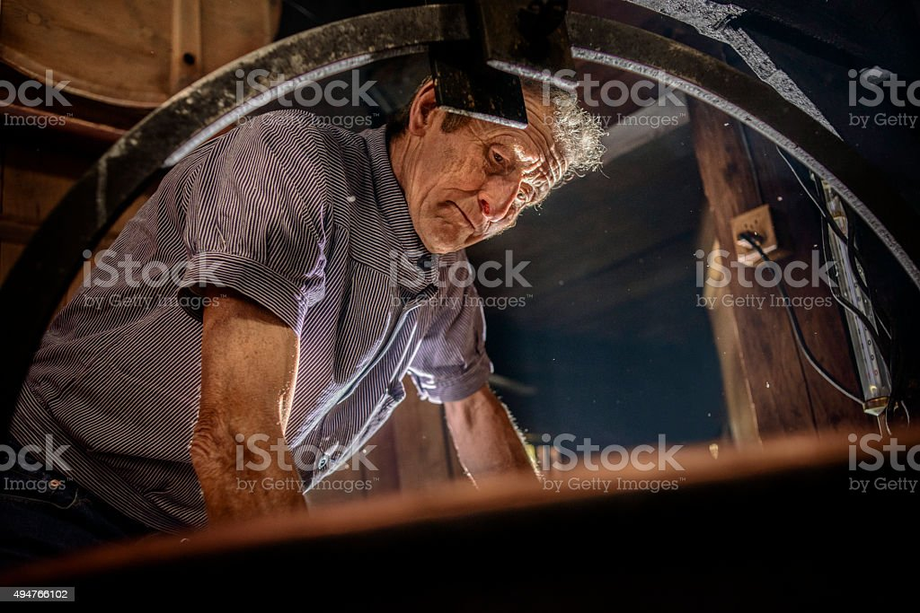Traditional Cheese Making in Swiss Alps stock photo