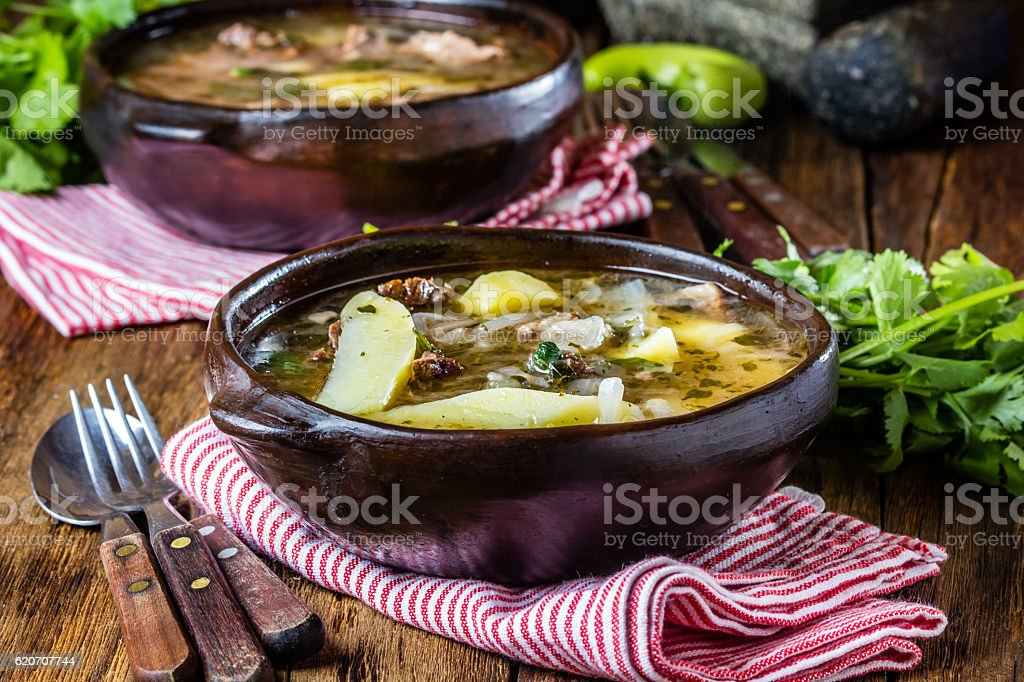 Traditional chilean latinamerican meat soup ajiaco served in clay plate stock photo