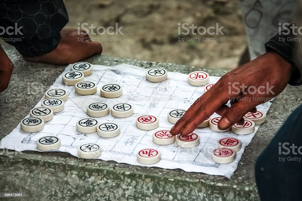 Traditional Chinese Chess game played on paper stock photo