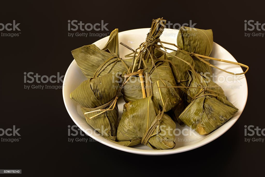 Traditional Chinese food chimaki wrapped in bamboo leaf stock photo