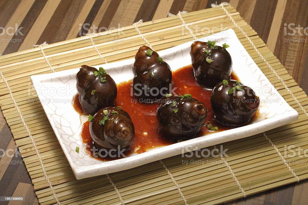 Traditional chinese food Winkle on dish stock photo