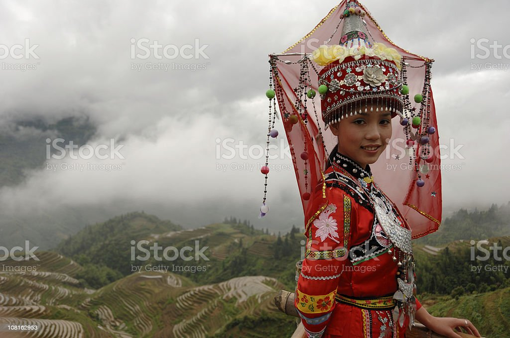 Traditional Chinese Girl in Dong Costume Outside stock photo