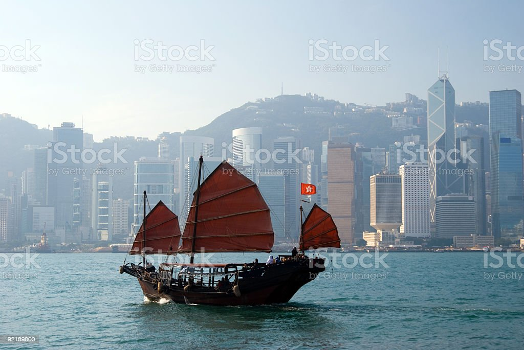 Traditional Chinese Junkboat sailing across Hong Kong Harbour royalty-free stock photo