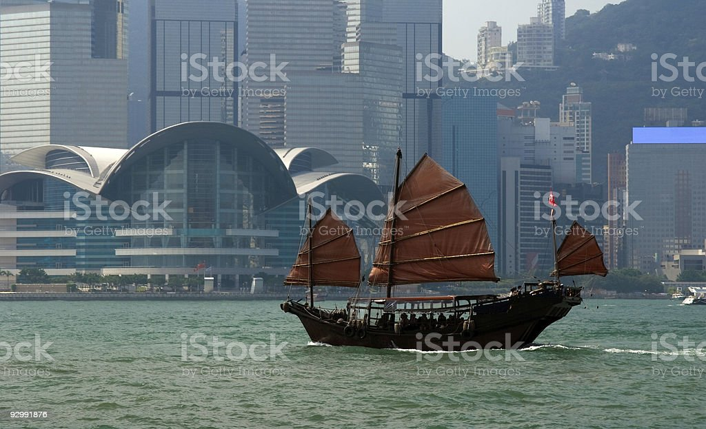 Traditional Chinese Junkboat sailing across Hong Kong Harbour stock photo
