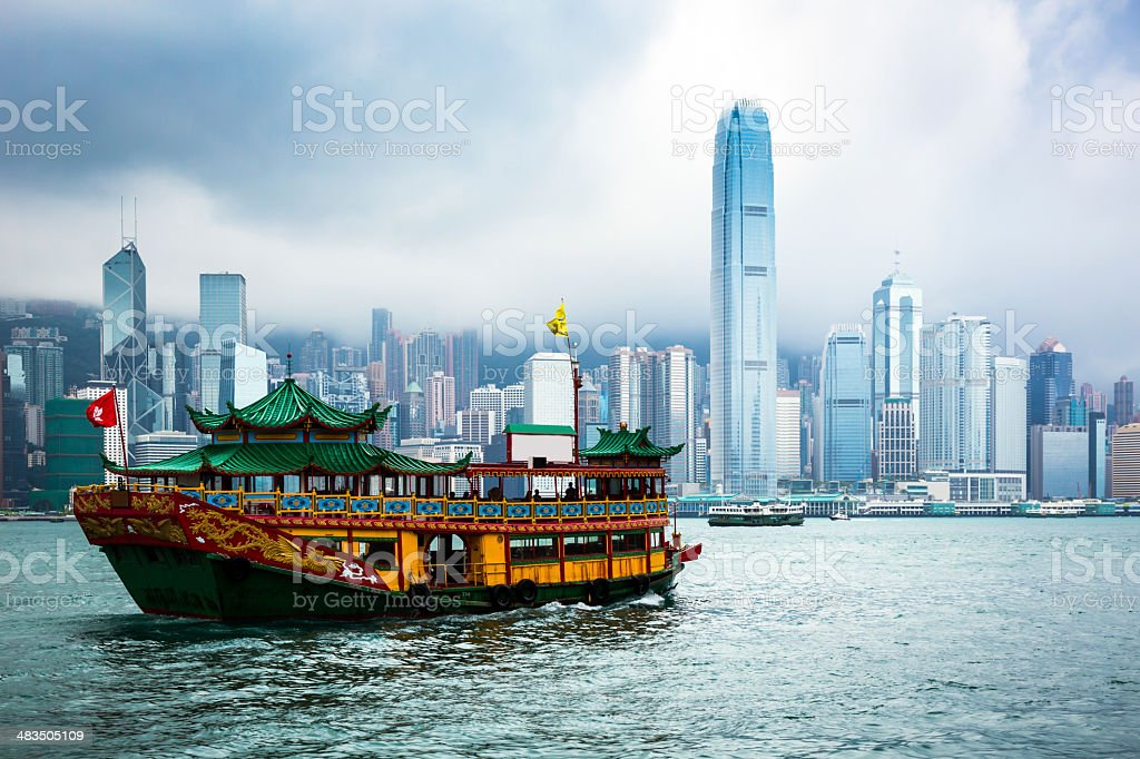 Traditional Chinese Junkboat Sailing Across Victoria Harbour stock photo