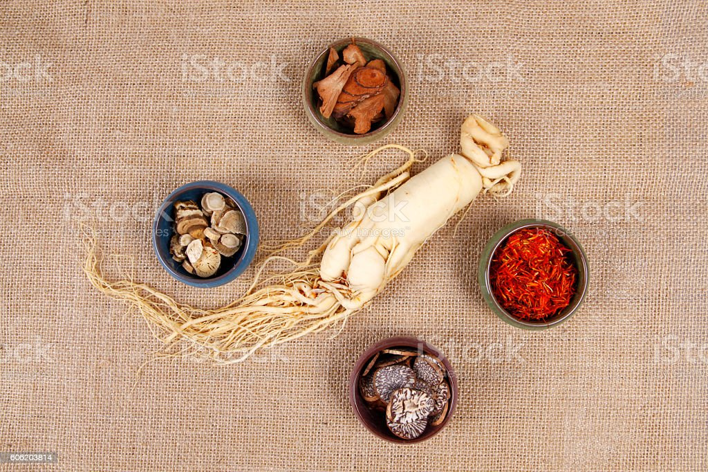 Traditional Chinese medicine (TCM) and ginseng, close-up stock photo