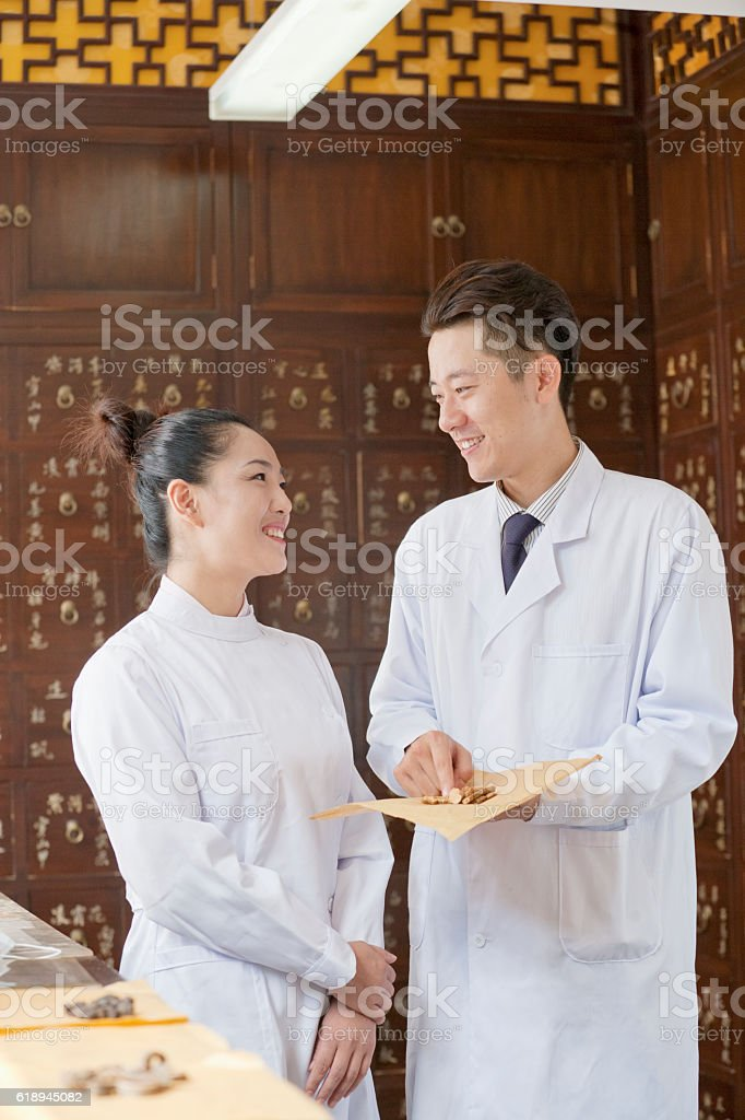Traditional Chinese medicine doctors talking stock photo