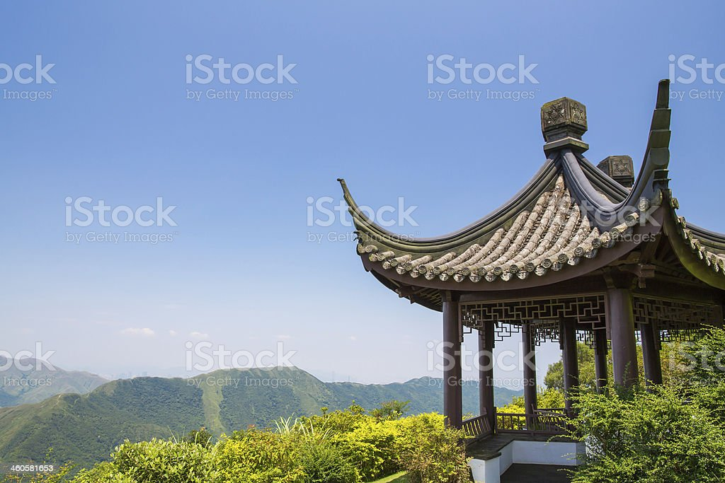 Traditional Chinese pavilion on a lush mountain stock photo