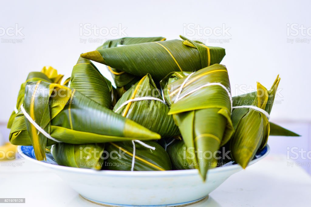 Traditional Chinese Rice Dumplings, Zongzi, Placed in a White Plate. Isolated. stock photo