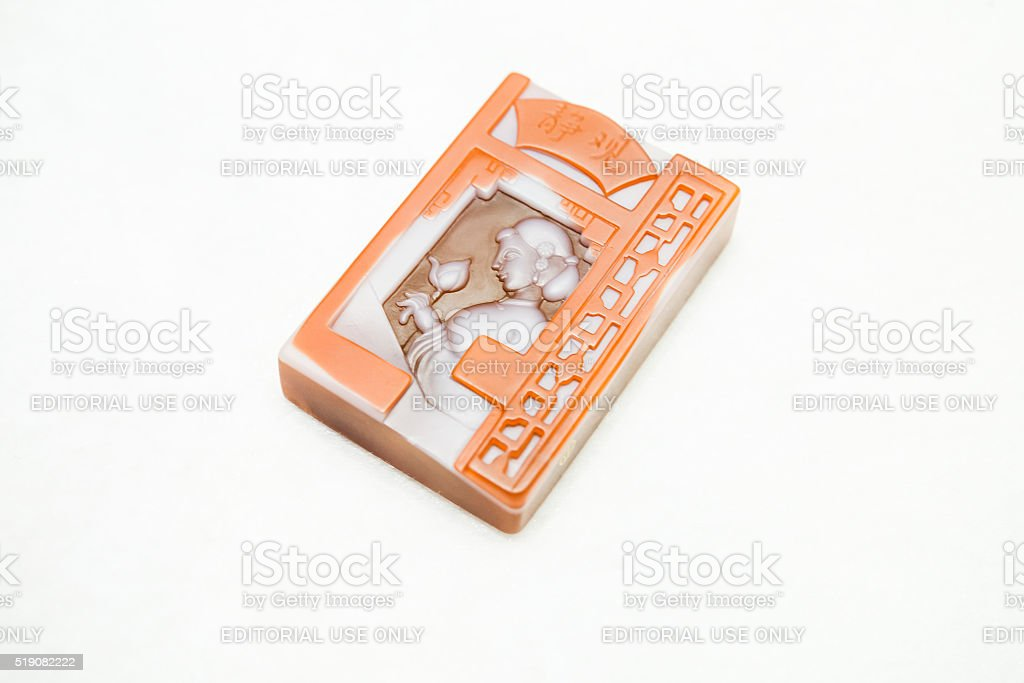 Traditional Chinese stone amulet with woman stock photo