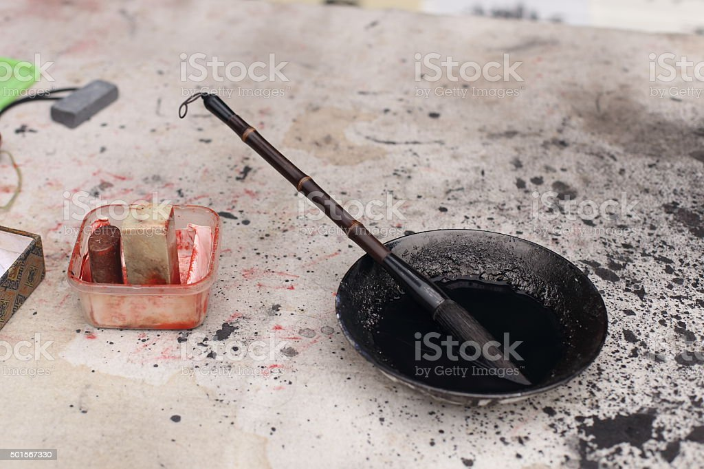 Traditional Chinese writing brush in the black ink stock photo