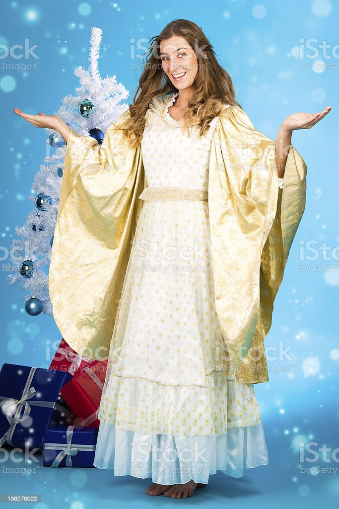 Traditional Christmas Angel in front of tree royalty-free stock photo