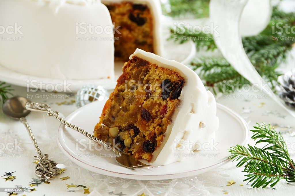 Traditional Christmas fruit cake with candied fruit and fruit. stock photo