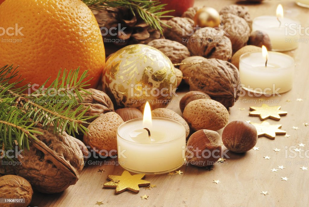 traditional christmas nuts and candles decoration royalty-free stock photo