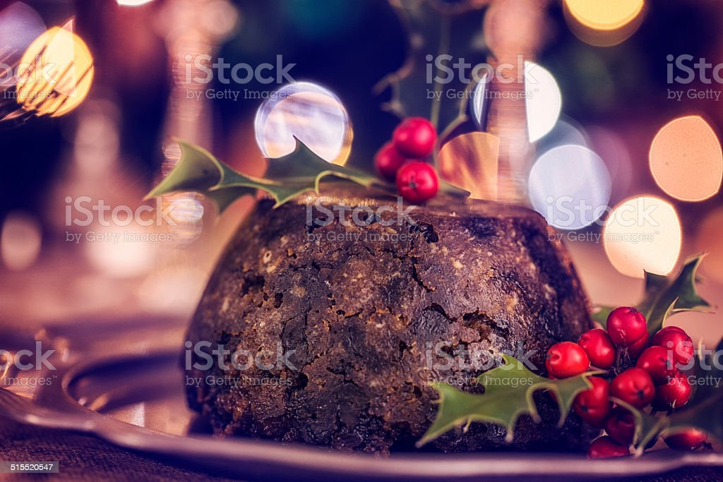 Traditional Christmas Pudding Served on a Plate stock photo