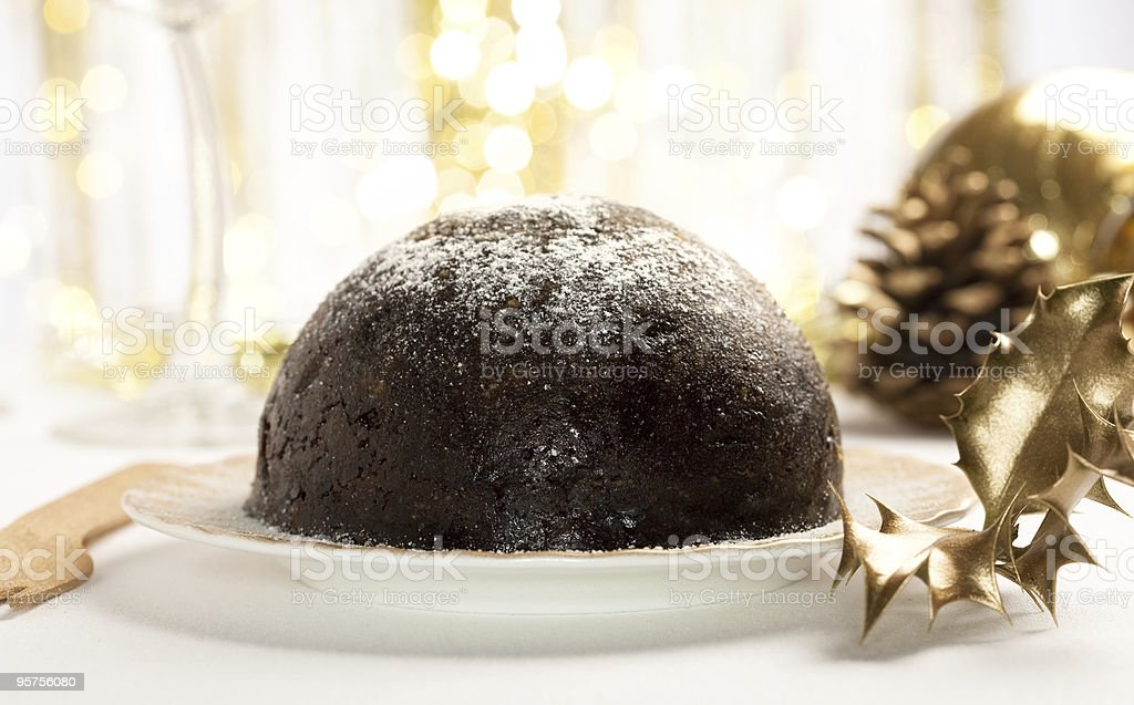 traditional christmas pudding with golden decorations, shallow D royalty-free stock photo