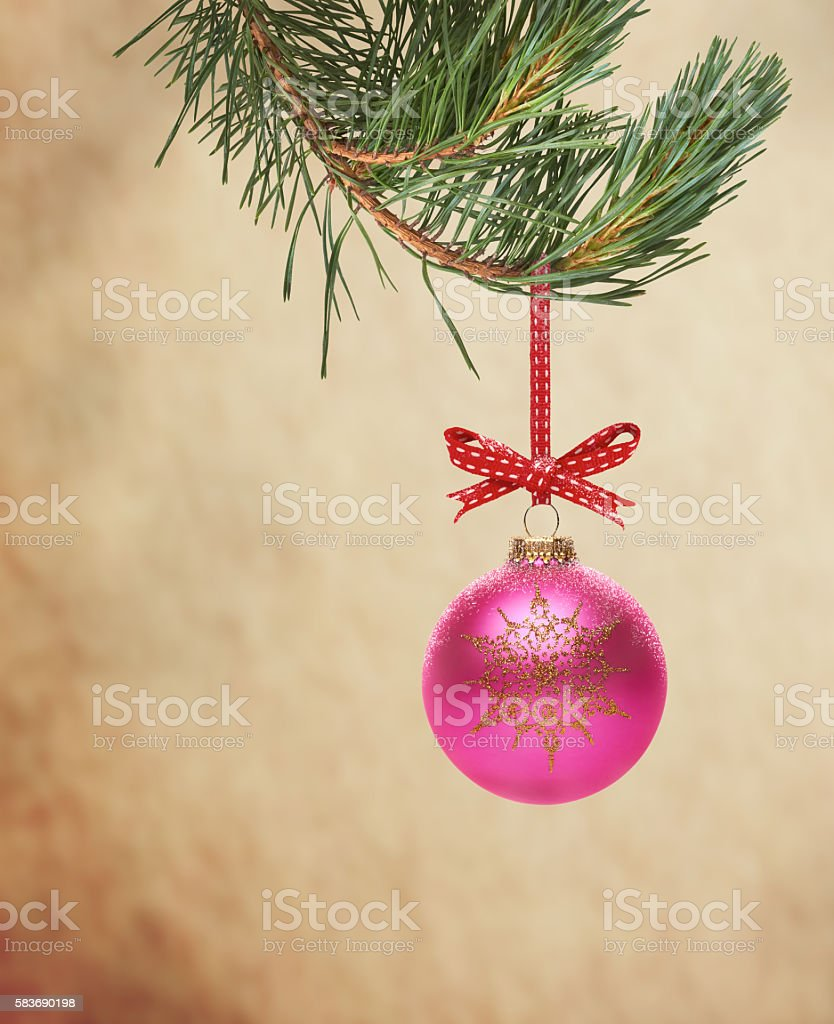 Traditional Christmas Tree Decoration hanging from a tree branc stock photo
