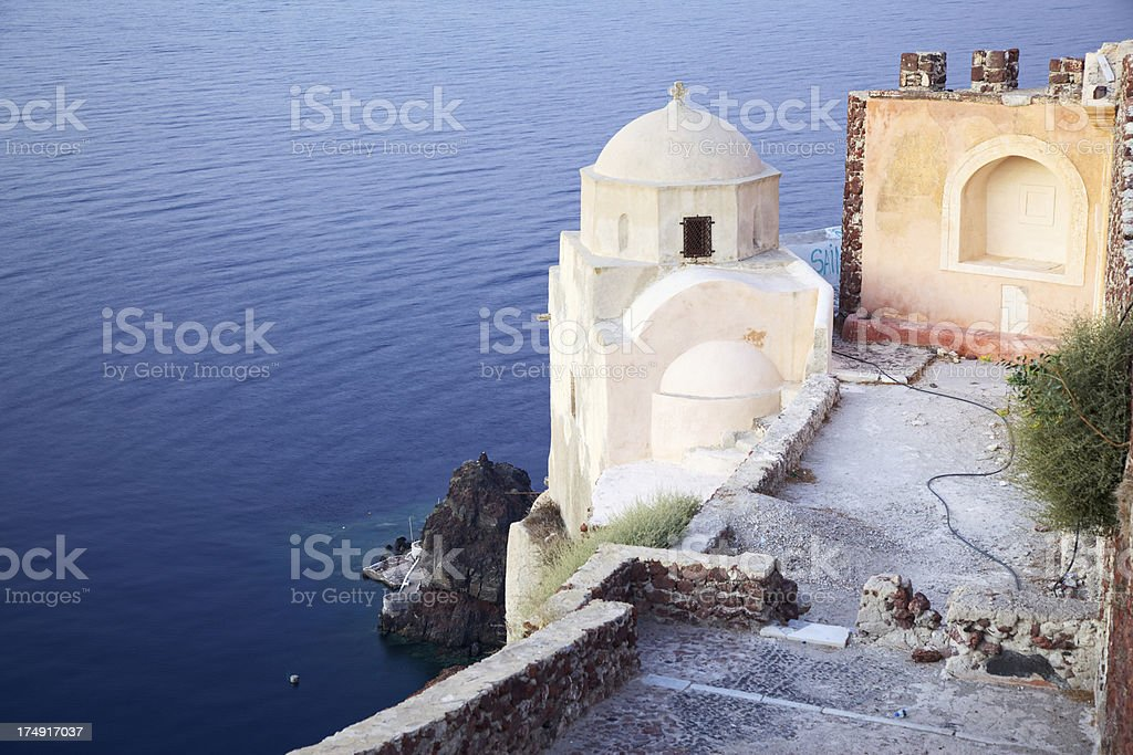 Traditional church in Oia village at sunset.  Santorini. Greece. stock photo