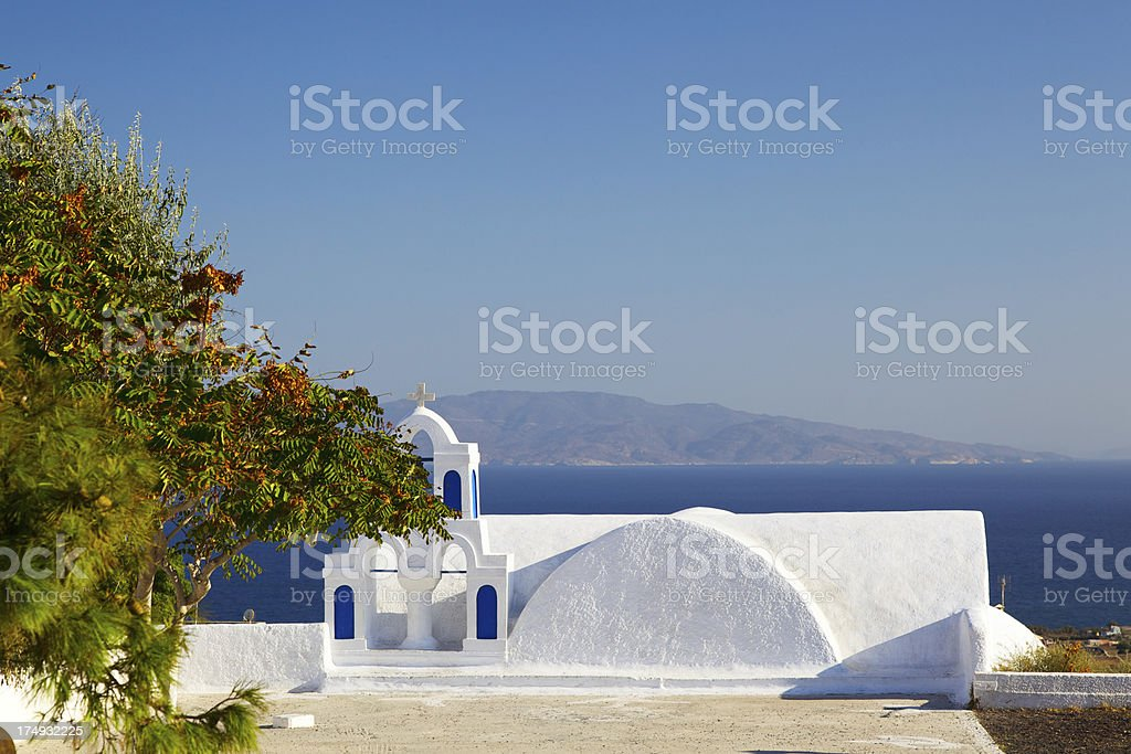 Traditional church with bell tower in Oia village.  Santorini. Greece. royalty-free stock photo