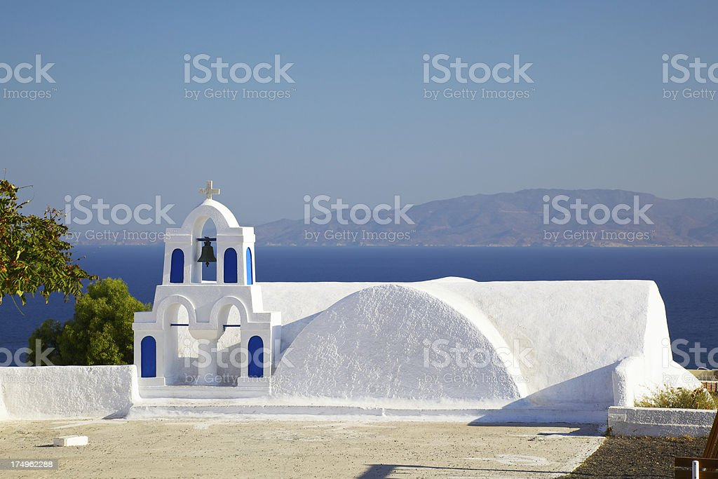Traditional church with bell tower in Oia village.  Santorini. Greece. stock photo