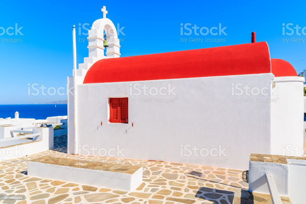A traditional church with red roof on Mykonos island, Cyclades, Greece stock photo