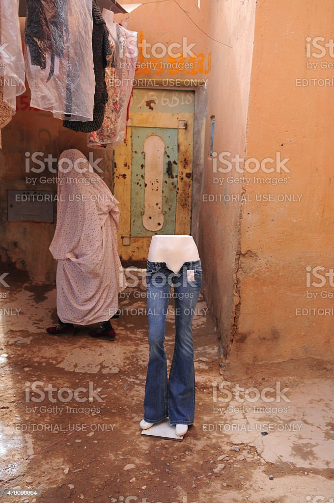 Traditional clothing against modern fashion. stock photo