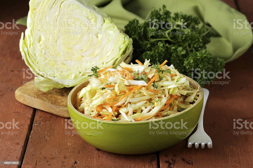 Traditional coleslaw (cabbage salad, carrot and mayonnaise) stock photo