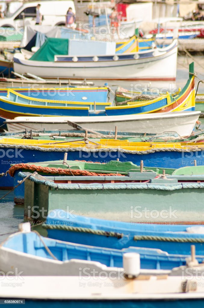 Traditional Colored Fishing boats in Marsaxlokk harbor, Malta stock photo