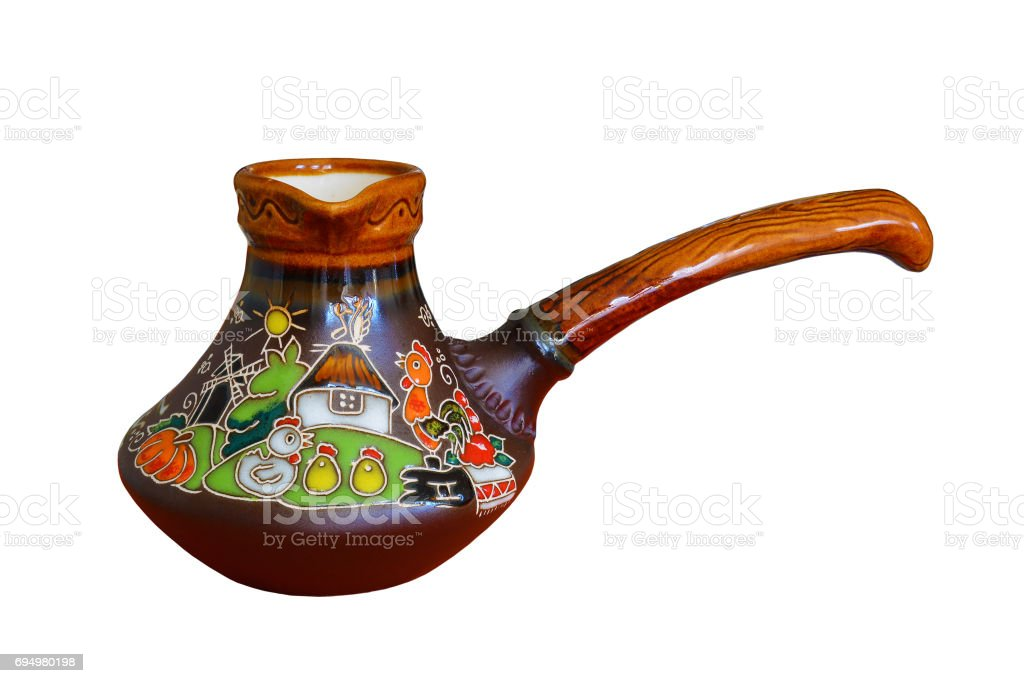 Traditional colored pottery, painted ceramic coffee pot. Isolated, white background. stock photo