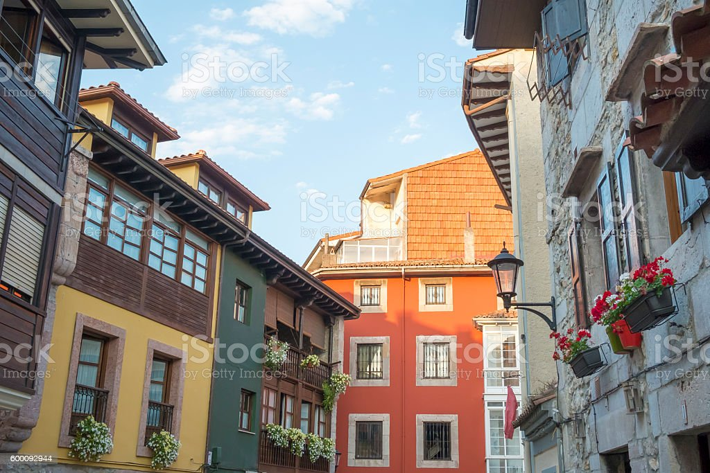 Traditional colorful facades in Llanes, Asturias, Spain. stock photo