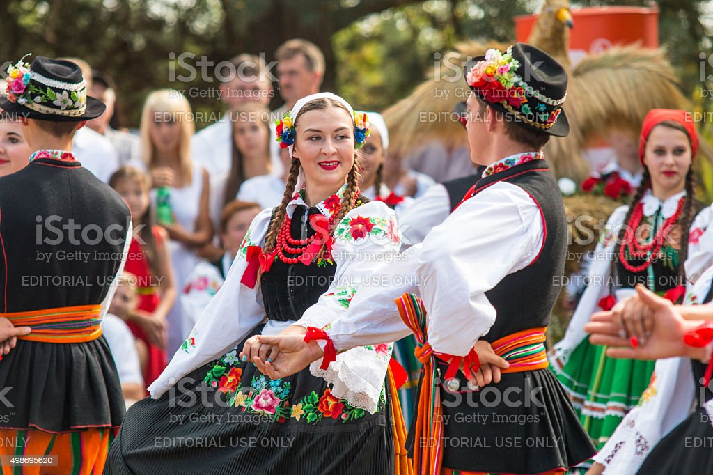Traditional colorful folk dance group from Lowicz, Poland stock photo