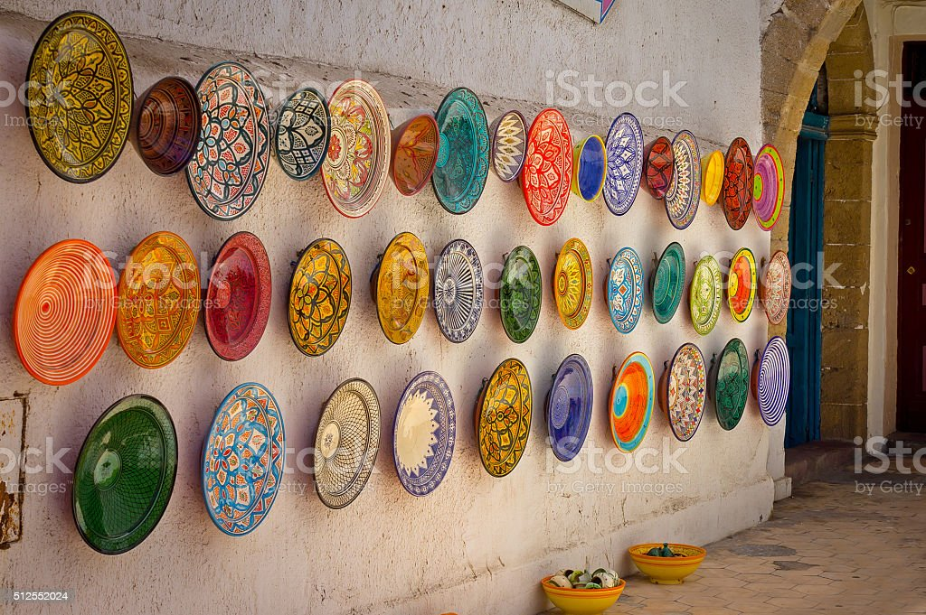 Traditional colorful Moroccan plates on the street walls of Marrakesh. stock photo
